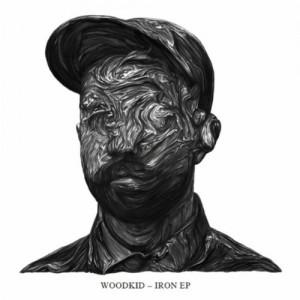 Paroles de chansons et pochette de l'album Iron de Woodkid
